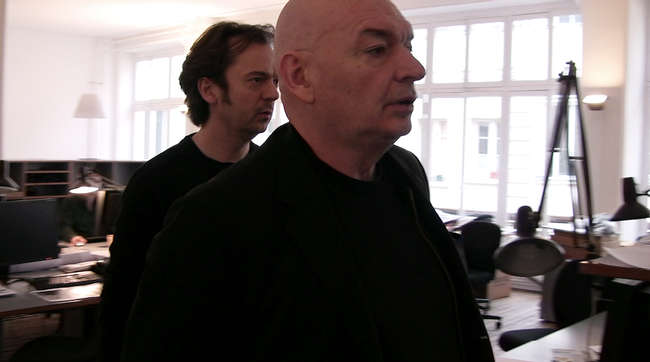 Still from <em>The Competition</em>: Jean Nouvel critiques his project team's design for a museum in Andorra.