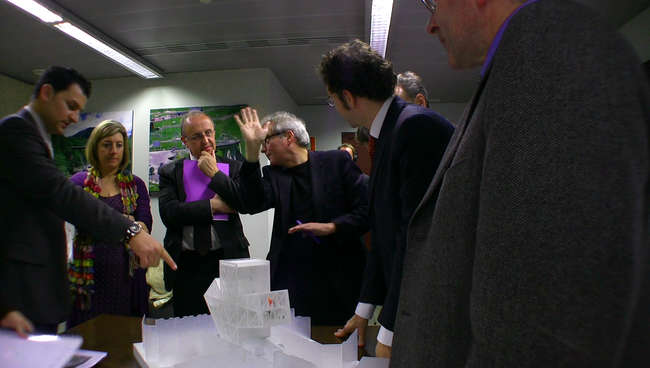 Still from <em>The Competition</em>: Dominique Perrault (with hand up) presents his scheme to the jury.