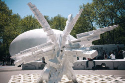 At the Ideas City street fair: An installation made from discarded styrofoam by Terreform ONE rises in front of Raumlabor's <em>Spacebuster</em>, a mobile inflatable pavilion comissioned by the Storef
