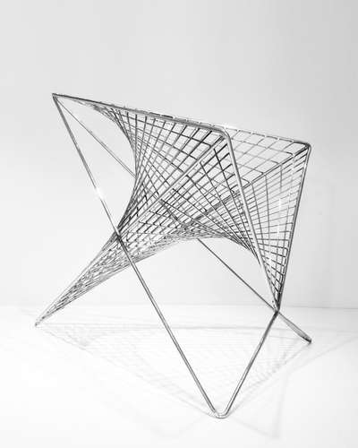 <strong>At ICFF</strong><br /> Los Angeles architect Carlo Aiello&#8217;s 'Parabola Chair.' Though it&#8217;s geometry curves in two directions, all of the chair&#8217;s components are straight and si