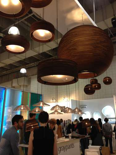 <strong>At ICFF</strong><br /> Cardboard light fixtures at the Graypants Studio booth.