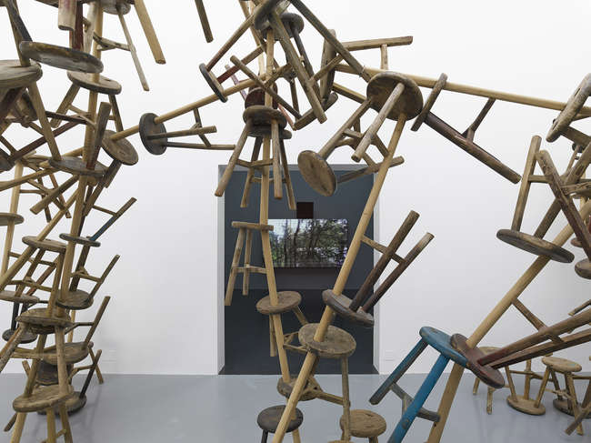 The German Pavilion includes work by artists Romuald Karmakar, Santu Mofokeng, Dayanita Singh, and Ai Weiwei. Above, Ai's <em>Bang</em>, 2010-2013, which comprises 886 antique stools.