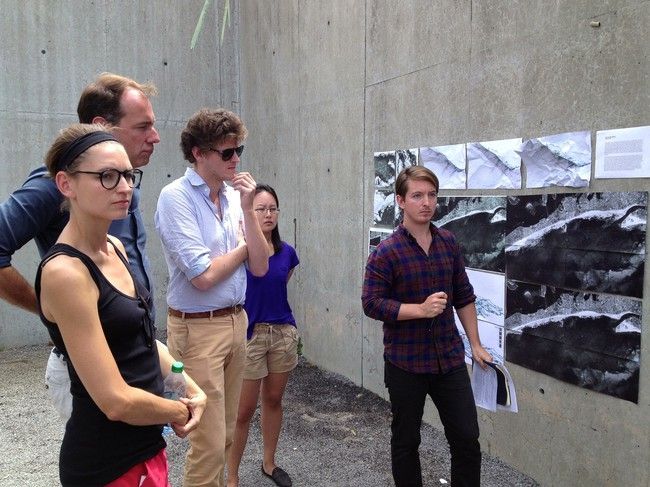 From left to right: Visiting critics Johanna Meyer-Grohbrügge, Niklas Maak, and Sam Chermayeff stand with students Yoonjee Koh and Stefan di Leo, who are living at the Colony at MoMA PS1.