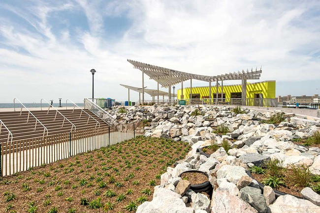 Sage and Coombe Architects' trellised canopies perch in front of restored concession stands in Queens, N.Y.