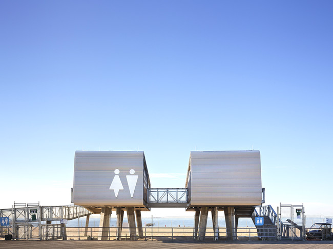 A Coney Island comfort station by Garrison Architects is one of 35  permanent steel-framed modular structures that have been deployed in Queens, Brooklyn, and Staten Island.