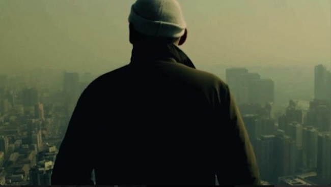 <p>Film Still from <em>REM</em>:</p><p>The architect surveys views from the top of the CCTV Headquarters in Beijing</p>