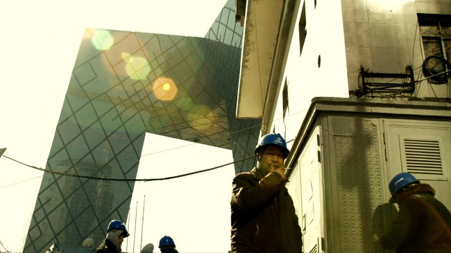 <p>Film Still from <em>REM</em>:</p><p>Workers at the CCTV Headquarters construction site</p>