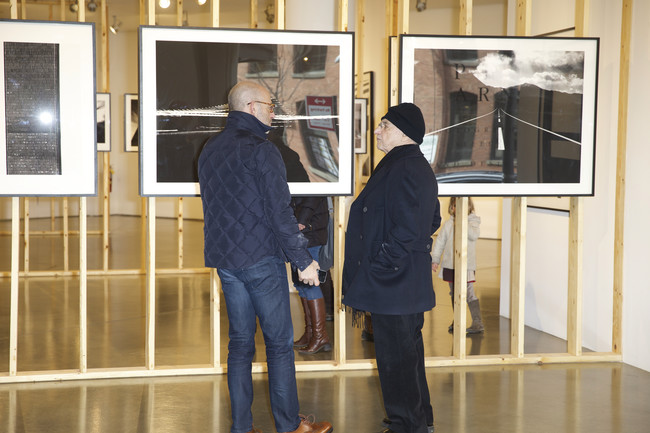 Peter Arnell and Frank Gehry at Milk Gallery, where the architect has curated a show of the businessman's photographs.