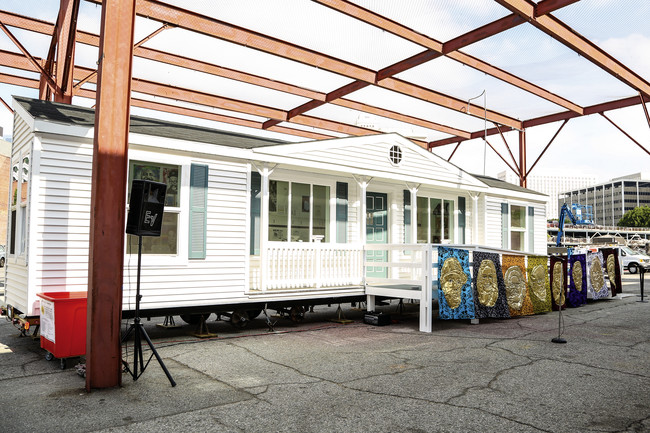 <em>Mobile Homestead</em> was developed by Kelley with Artangel and the  Museum of Contemporary Art Detroit as a community space, and is based on  the artist's childhood home in the Detroit suburb of