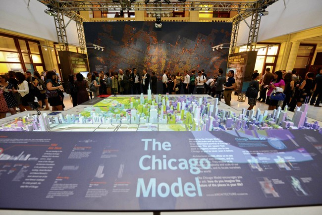 At the Chicago Architecture Foundation's exhibition on big data, a resin  model of Chicago has been digitally enhanced to project statistics on  everything from demographics to tweets.<div id='_mcePas