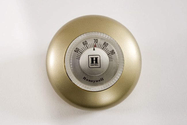 Henry Dreyfuss. Honeywell Round Thermostat, 1953. Plastic and painted aluminum housing, 3 in. diameter.