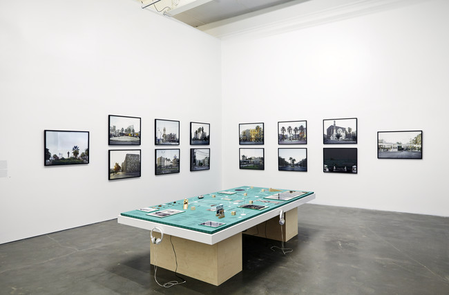 Rana Hamadeh's <em>The Big Board or &#8216;And Before It Falls It Is Only Reasonable To Enjoy Life A Little&#8217;</em> (2013) is surrounded by Hrair Sarkissian's photographs <em>Execution Squares</em