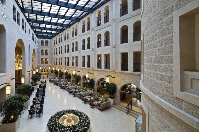 The atrium promenade features a retractable glass ceiling that floods the hotel with natural light.