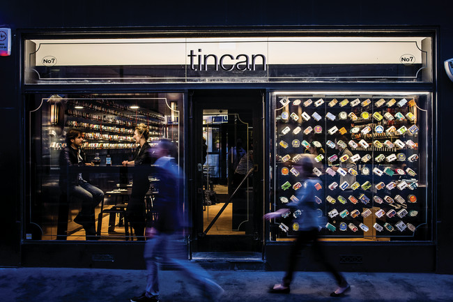 Tincan, an ongoing Soho pop-up restaurant conceived and operated by architect AL_A, offers a menu comprising 25 varieties of canned seafood, from humble sardines to $35 scallops. The colorful packagin