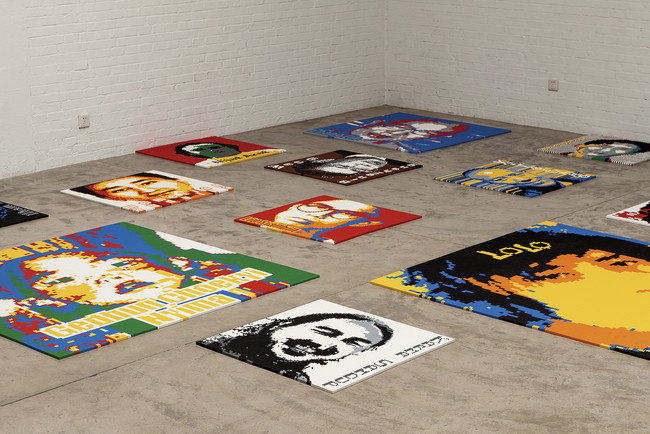For <em>Trace</em>, the artist paved the large concrete hall of the New Industries Building with 176 Lego portraits of political exiles and prisoners.