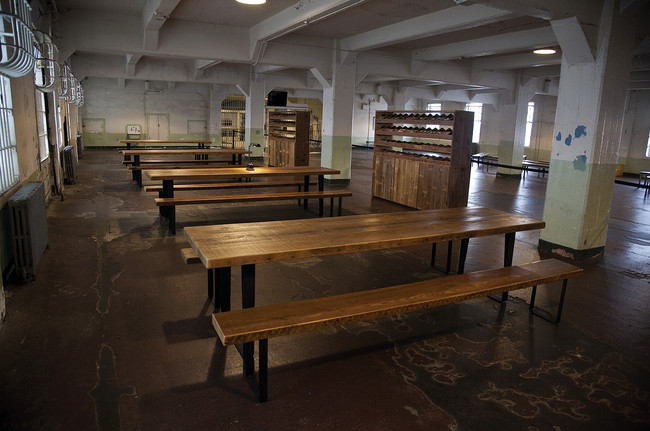 In the prison dining room, <em>Yours Truly</em> invites Alcatraz&#8217;s visitors to write messages on postcards pre-addressed to prisoners of conscience around the world.
