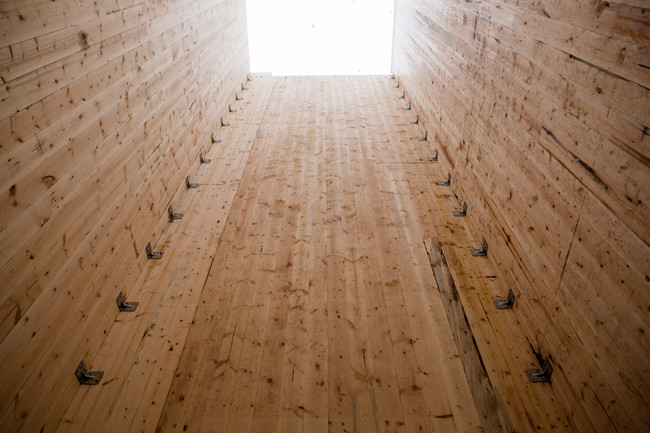 Even the building's core, its primary lateral-load resisting system, is wood. The core consists of cross-laminated timber panels.