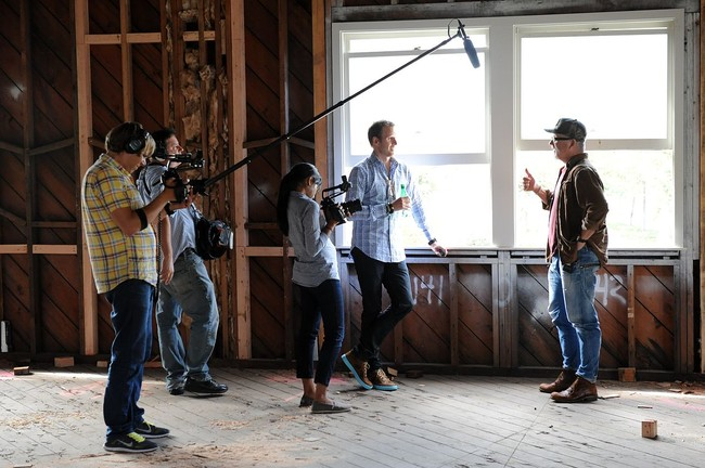 The film crew, including Bassett (center) talks to John Boiler, CEO of 72andSunny, a design and advertising agency.<div id='_mcePaste'>&#65279;&#65279;