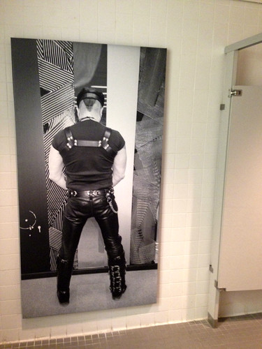 In a men's bathroom at the Bass Museum, a photo of Peter Marino suggests the room's use.<div id='_mcePaste'>&#65279;&#65279;