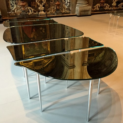 Massimiliano Locatelli's new table for Glas Italia, made entirely of glass, was exhibited in the architect's new offices inside the church of San Paolo Converso.