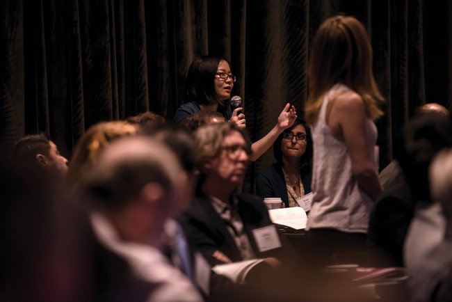An attendee participates in a q&a session. <br />