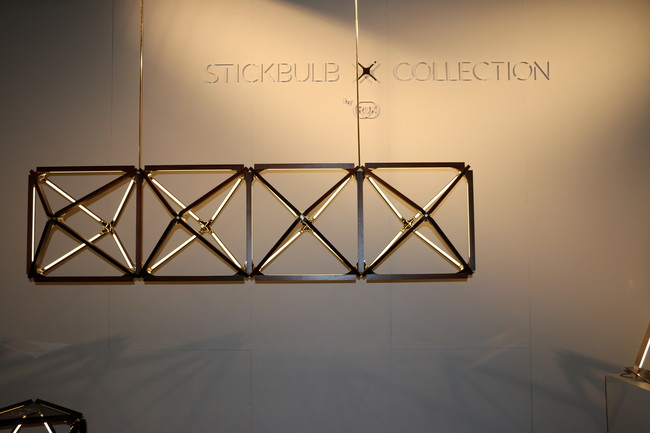 Modular chandeliers comprised of brass, wood, and LEDs are part of Long Island City-based RUX&#8217;s new Stickbulb X Collection.<div id='_mcePaste'>&#65279;&#65279;