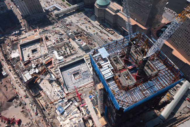 Redevelopment of Lower Manhattan's World Trade Center site has been beset with problems, from design changes to funding woes. For years, a chain-link fence has surrounded the 16-acre parcel. But nine