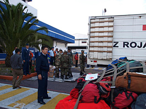 Ecuadorian army personnel gather up items to ship to Haiti.