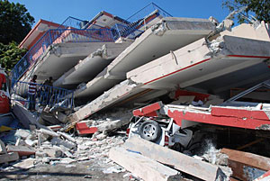 Collapsed two-, or possibly three-story reinforced concretebuilding in Port-au-Prince, Haiti.
