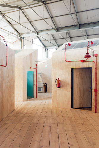 For the Red Bull Music Academy, the abstract and figurative paintings of Philip Guston helped inspire the whimsical gathering of house-like rehearsal rooms along a raised walkway.