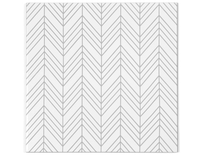 Tile designer Erin Adams puts her patterned-fabric-inspired stamp on a ceramic series for Imagine Tile. The Slant Stitch by Erin Adams Collection features herringbone motifs with variegated spacing an