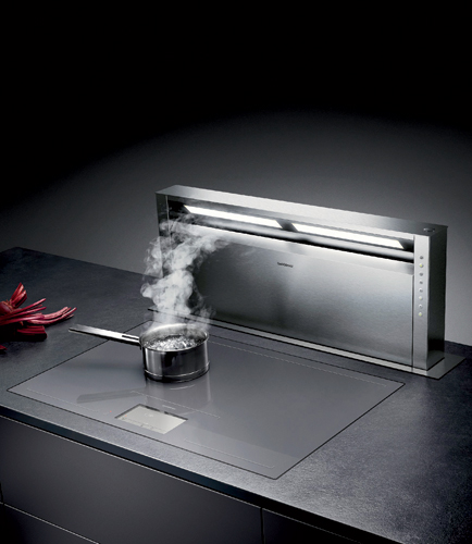 A discreet alternative to the traditional range hood, the AL 400 downdraft ventilation system fully retracts into a countertop at the touch of a button when not in use. Ideal for island gas or inducti
