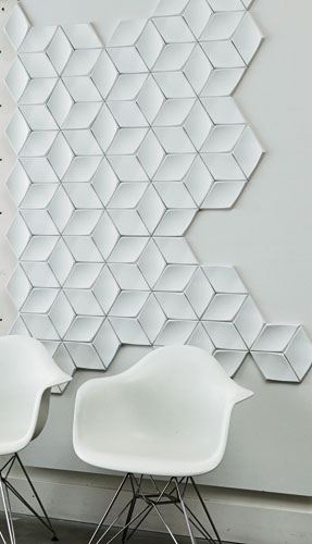 Swoon, newly added to Studio by 3form's Profile series, is a dimensional diamond-shaped tile with skewed bevel edges  and a subtly concave face, affording designers the ability to create intriguing ge