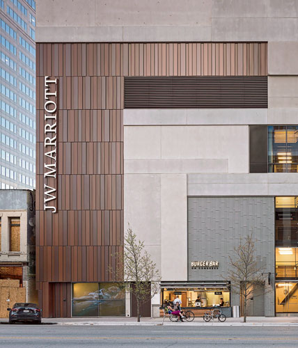 For the JW Marriott in Austin, Texas, HKS Architects wanted to specify weathered steel, but its cost was too high. The firm's contractor worked with metal-wall manufacturer ProCLAD and selected 18-gau