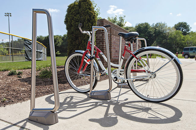 "Its unornamented design makes Summit Bike Rack a functional piece that can meld with any outdoor or curbside setting. Formed of 1½""-diameter stainless-steel tubing, it features a fr"