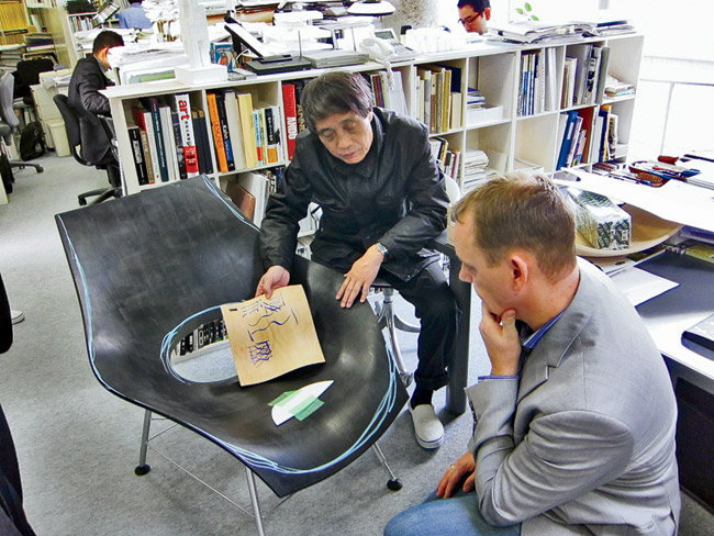 Ando examines an early mock-up at his Osaka studio.