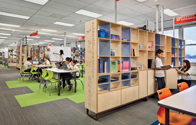 At the William P. Gray School in Chicago, the first school to implement the Learning Module furniture system, the units feature a combination of open storage cubbies, cabinet doors, sliding whiteboards, and power/ data poles, and partitions off the various learning zones.