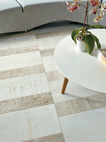 Crossville's first digitally produced line, Reclamation, is a collection of porcelain tiles that feature patterns and textures inspired by reclaimed materials, which continue to be popular design elem
