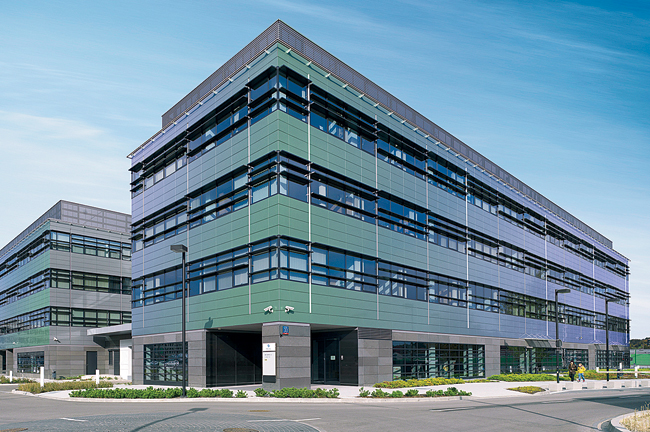 Alcoa has introduced a new finish for its Reynobond aluminum-composite cladding  that creates a dramatic visual effect. Shown installed on a business park complex in Warsaw, Poland, PrismFX shifts col