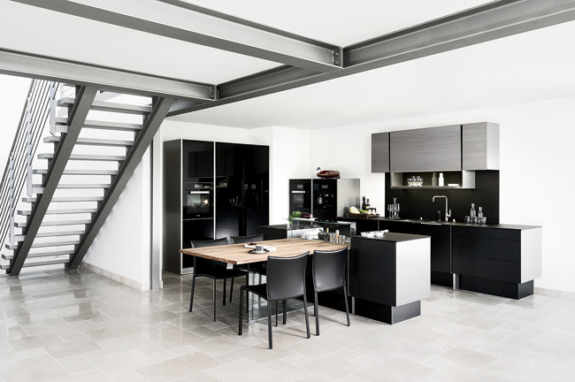 Six years ago, Porsche Design Group collaborated with Poggenpohl on a high-end kitchen defined by clean lines, handle-free fronts, and a slick aluminum frame. This follow-up continues to emphasize pre