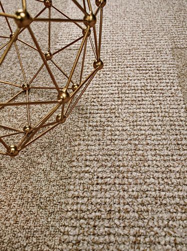 These two complementary commercial carpets feature a lush hand created by using vintage tufting equipment. Constructed of Antron nylon in a sophisticated neutral palette, both are available in modular