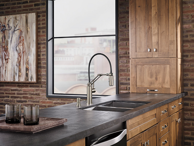 This single-handle, articulating-arm kitchen faucet by Brizo is reminiscent of the classic Luxo task light with a flexible pull-down design. When the two-function spray wand is undocked, the user can