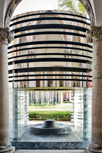 New York–based Steve Blatz and Antonio Pio Saracino designed a small tower in wood, glass, and steel in the main courtyard at the University of Milan.