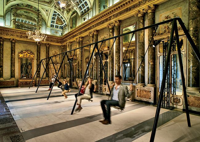 Visitors enjoy a swing set Philippe Malouin created for Caesarstone in an 18th-century palazzo.