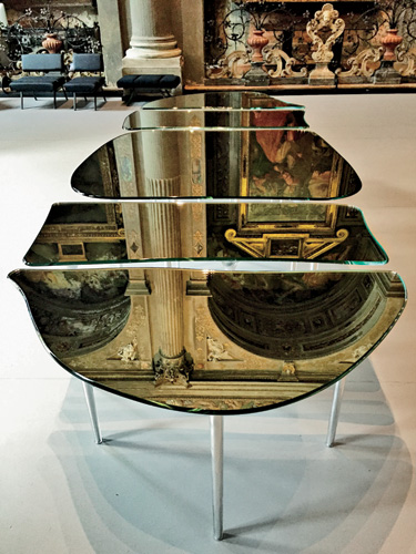 Massimiliano Locatelli's all-glass table for Glas Italia at his firm's office in a deconsecrated church.