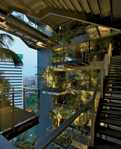 A vertical garden planted with palm trees cuts through the center of the tower. Guests access rooms via galleries overlookingthe greenery.