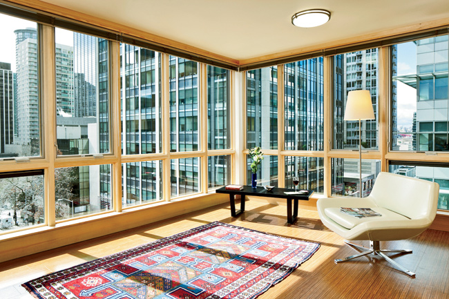 The apartments feel bright and open, despite their compact size, especially in the corner units, where the wood-framed windows extend almost from floor to ceiling.