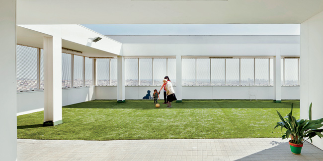 On the rooftop, the building has a public sun deck covered in artificial turf.