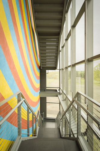 Detail of east staircase with view of Sol LeWitt's <em>Wall Drawing #559</em> (conceived 1996, redrawn, 2013) &copy;The LeWitt Estate/Artists Rights Society (ARS).