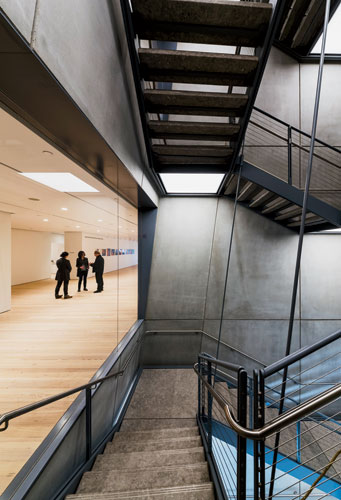 Enclosed by precast-concrete panels and suspended from steel cables, the main stair provides access to all floors.